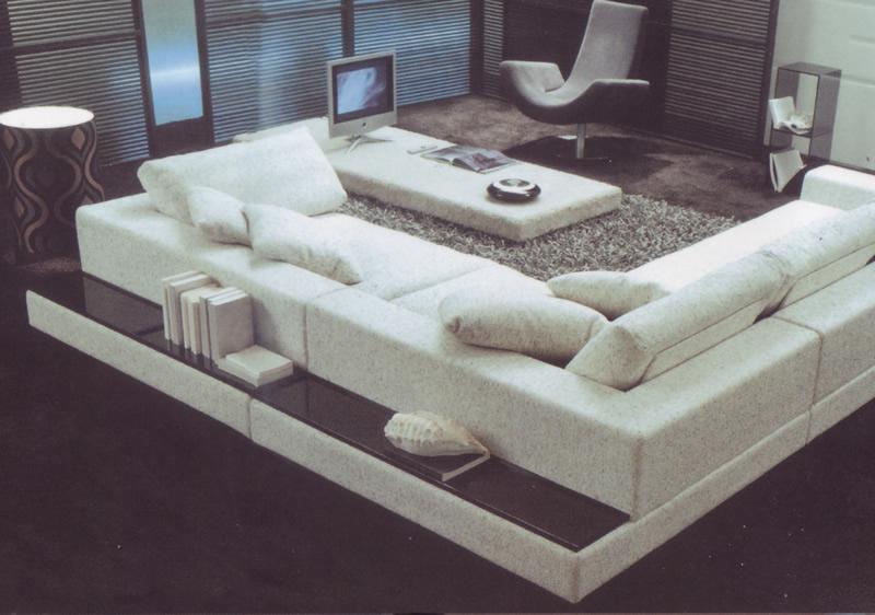 Divano con libreria nello schienale idee per il design for Cosa mettere dietro il divano